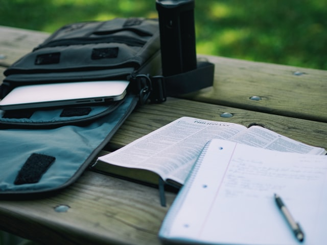 Laptop, Notebook and Pen to Review Lessons Effectively